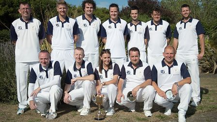 The Warboys White Hart team celebrate retaining the Durham Centenary Trophy. They are back row, left