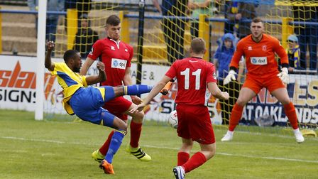 Ralston Gabriel drill the ball towards goal. Picture: LEIGH PAGE