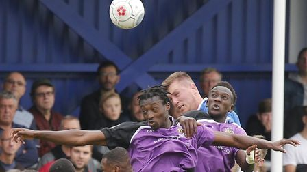 Richard Sho-Silva and David Moyo compete to keep the ball away from the Strong Billericay attack. Pi