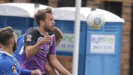 Sam Merson drills a header towards goal. Picture: Leigh Page