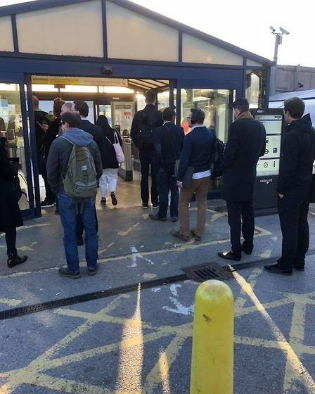 A queue of Thameslink passengers waiting to get onto platform four at St Albans City station this mo