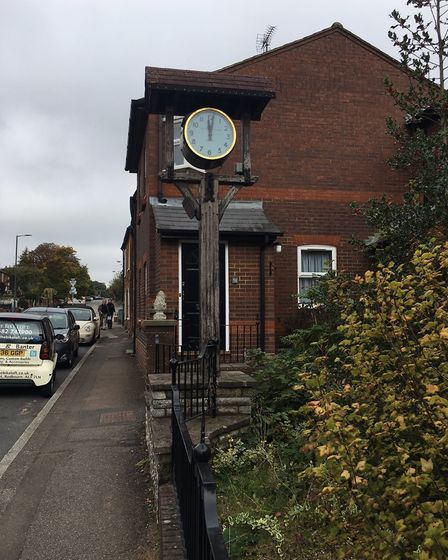 """An inscription reads: """"The High Street clock was reinstated by the community 15 Sept 2001"""""""