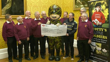 Huntingdon Male Voice choir hand over charity cheque
