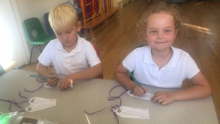 Barnaby and Sienna writing their tags. Picture: Therfield First School