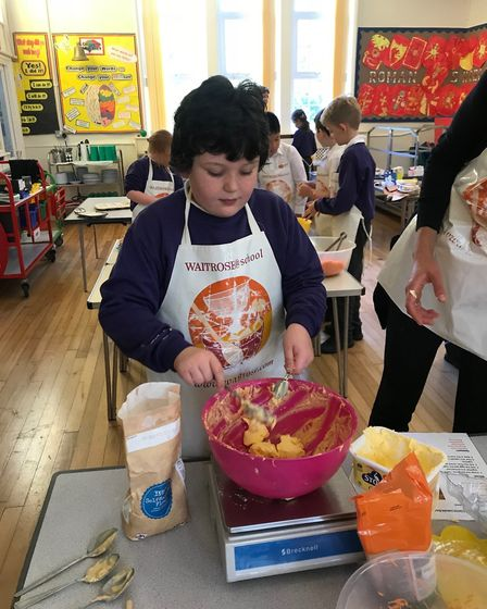 Jack Wilson, Year 3, weighing the butter. Picture: Therfield First School