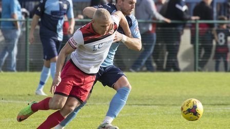 Recent signing Russell Short does battle with a Kettering Town opponent during St Neots Town's defea