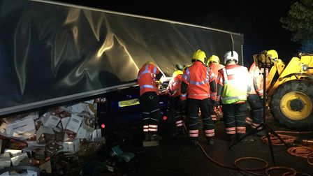 Fire crews rescued drivers from the car that was trapped under the lorry near Warboys