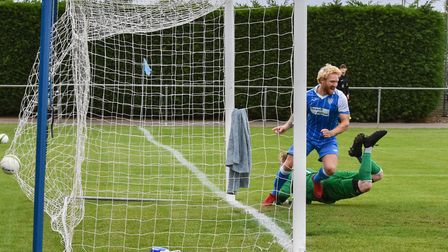 Craig Smith pounces for his 50th Eynesbury Rovers goal in their victory at Deeping Rangers. Picture: