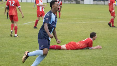 Dion Sembie-Ferris celebrates St Neots Town's second goal as their FA Cup fightback gathers pace. Pi