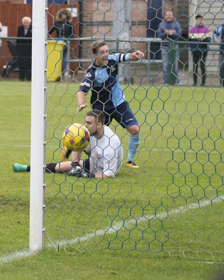 Johnny Herd hits the St Neots Town equaliser against Romulus. Picture: CLAIRE HOWES