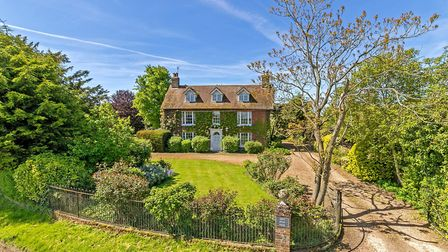 The Grade II listed home has eight bedrooms and a two-bed guest cottage. Picture: Strutt & Parker