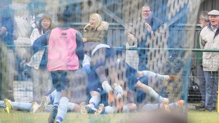 St Neots Town players celebrate the winning goal in their dramatic 4-3 victory against Romulus in th