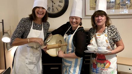 Staff at Elphicks getting ready for the coffee morning