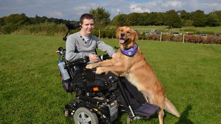 St Albans man Paul Phillips and Ralph, the golden retriever who has won an award from the Internatio