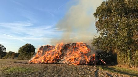 Fire crews are attending a 800 tonne haystack fire in Harpeden. Picture: Jeremy Weightman