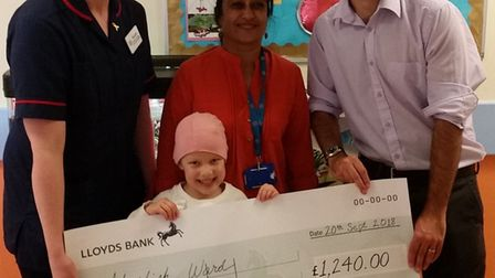 Cora Varshney with her cheque and members of Watford General Hospital. Picture: Alanna Varshney.