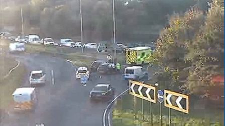 An ambulance and police car parked up on the A414 Park Street roundabout. Picture: HCC.