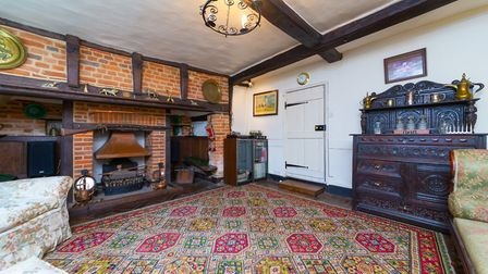 Features include fine exposed timbers and impressive brick chimneys. Picture: Charter Whyman
