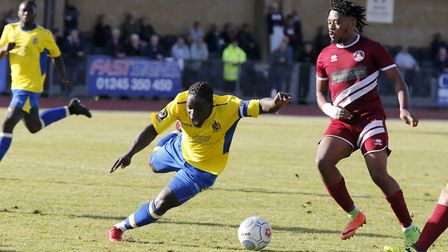 Solomon Sambou is brought crashing to ground to earn St Albans City their second penalty. Picture: L