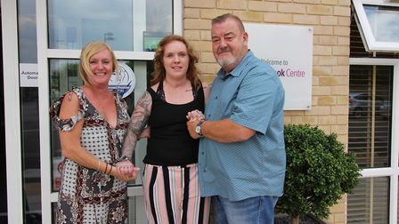 Levi with her parents Dave and Debbie at the Marbrook Centre in St Neots