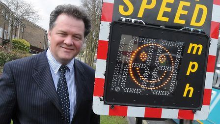 Hertfordshire Police and Crime Commissioner David Lloyd stood next to a sign indicating the speed of