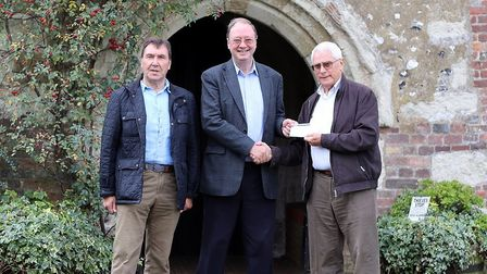 Andrew Lambourne (centre) from St Leonard's Church with Roger Saunders and Martin Yardley from Harpe
