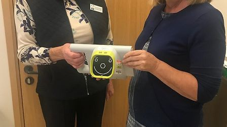 Diane Moore, Senior Orthoptist being presented with the equipment by Pat Butcher, Chairperson of The