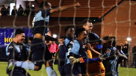 St Neots Town players celebrate their FA Cup third qualifying round replay triumph at Coalville Town