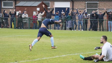 Dion Sembie-Ferris and St Neots Town supporters celebrate after his last-gasp winner completed their