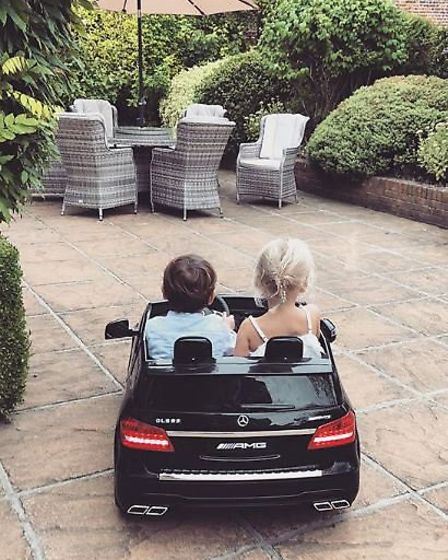 Living the dream: Sam's son and niece hitting the road in a miniature Merc. Picture: @samanthafaiers