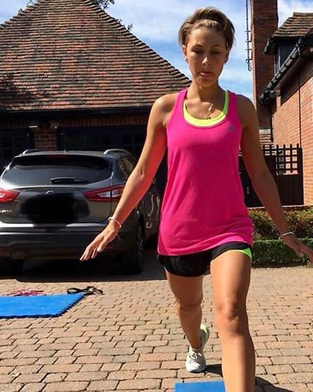 Emma working out outside her Hertfordshire home. Picture: @emmawillisofficial/Instagram