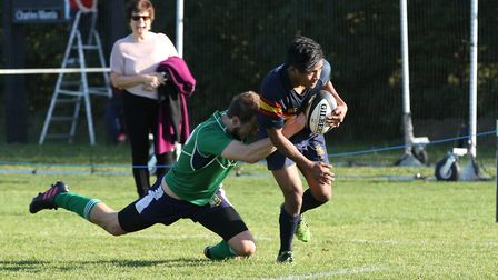 John Aguila goes for the line in the match between Datchworth and Tabard. Picture: DANNY LOO