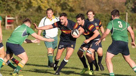 Dan Calnan runs at the defence in the match between Datchworth and Tabard. Picture: DANNY LOO