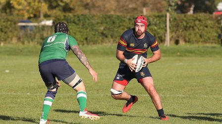 George Hurford carries forward in the match between Datchworth and Tabard. Picture: DANNY LOO