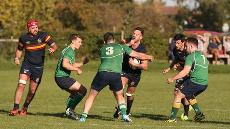 Dan Calnan takes a hit in the match between Datchworth and Tabard. Picture: DANNY LOO