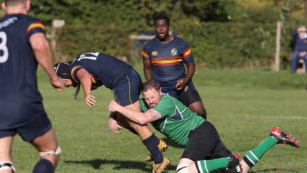 Mark Salteras is tackled by Tom Blackwell in the match between Datchworth and Tabard. Picture: DANNY