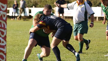 Liam Walker is held up by Jack Reilly in the match between Datchworth and Tabard. Picture: DANNY LOO