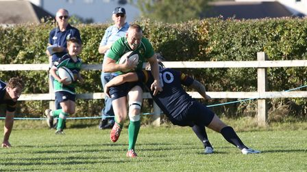 James Watt cuts inside Jack Reilly in the match between Datchworth and Tabard. Picture: DANNY LOO