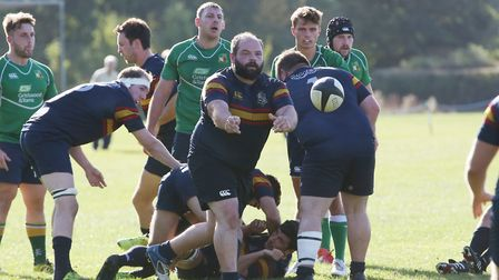 Wilf Lake passes off the back of a ruck in the match between Datchworth and Tabard. Picture: DANNY L