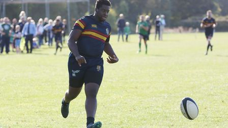 Deniyi Olashore chases back to collect a kick in the match between Datchworth and Tabard. Picture: D