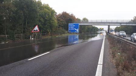 The burst water main on the M11. Picture: @HighwaysEAST