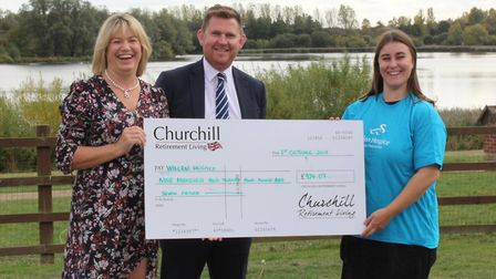 Jacqui Egan and Greg Hilton from the St Albans office of Churchill Retirement Living giving a cheque