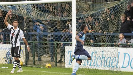 Nabil Shariff sets off in celebration following his last-gasp St Neots Town equaliser. Picture: CLAI