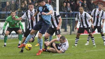 Taylor Parr in the thick of the action for St Neots Town during their FA Cup clash with Coalville To