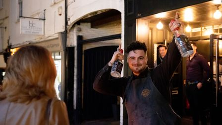 St Albans George Street Gin and Jazz event. A barman dazzling visitors at the event. Picture: Stepha