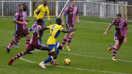 Percy Kiangebeni puts pressure on Corinthian Casuals. Picture: LEIGH PAGE