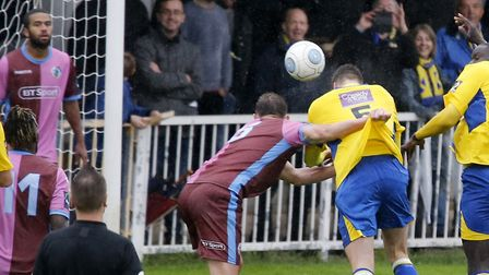 Lewis Knight drills a header towards goal. Picture: LEIGH PAGE