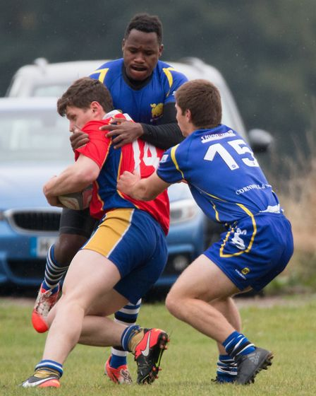 St Ives men Albiee Tayedzerwa and Joe Cox attempt to stop a Market Bosworth player. Picture: PAUL CO