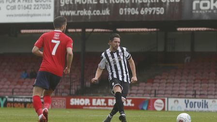St Ives Town captain Robbie Parker on the ball against York City. Picture: LOUISE THOMPSON