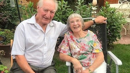 Peter and Phyllis Sizeland, pictured at a family garden party, are celebrating 65 years of marriage.